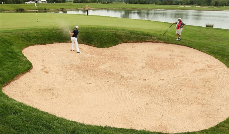 NEWPORT, WALES - JUNE 05:  Andrew Dodt of Australia plays out of the 13th greenside bunker during the third round of the Celtic Manor Wales Open on The Twenty Ten Course on June 5, 2010 in Newport, Wales.  (Photo by Warren Little/Getty Images)