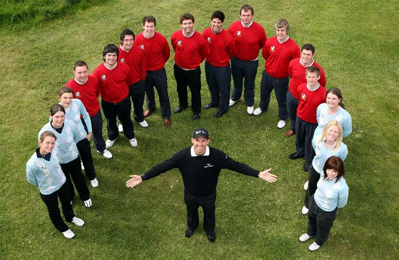 BALTRAY, IRELAND - MAY 13:  Padraig Harrington of Ireland poses for a photograph with some junior golfers from Maynooth College prior to the start of The 3 Irish Open at County Louth Golf Club on May 13, 2009 in Baltray, Ireland.  (Photo by Andrew Redington/Getty Images)