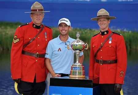 OAKVILLE, ON - JULY 27:  Chez Reavie poses with the winner's trophy and two Royal Canadian Mounted Police, 'Mounties' after winning the RBC Canadian Open at the Glen Abbey Golf Club on July 27, 2008 in Oakville, Ontario, Canada.  (Photo by Robert Laberge/Getty Images)