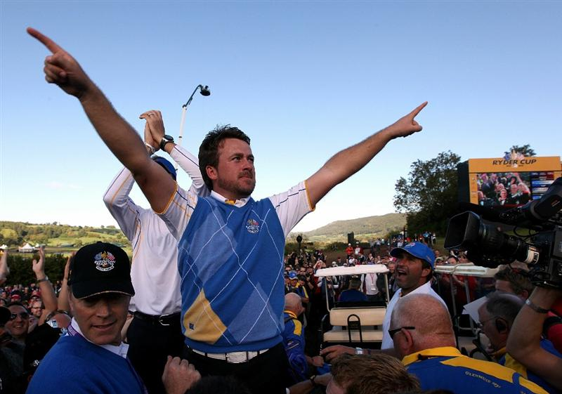 NEWPORT, WALES - OCTOBER 04:  Graeme McDowell of Europe celebrates his 3&1 win to secure victory for  the European team on the 17th green at the end of the singles matches during the 2010 Ryder Cup at the Celtic Manor Resort on October 4, 2010 in Newport, Wales.  (Photo by Jamie Squire/Getty Images)