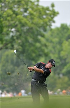 FORT WORTH , TX - MAY 24:  Phil Mickelson hits his approach shot into the 1st hole during the third round of the Crowne Plaza Invitational at Colonial Country Club on May 24, 2008 in Fort Worth, Texas.  (Photo by Marc Feldman/Getty Images)
