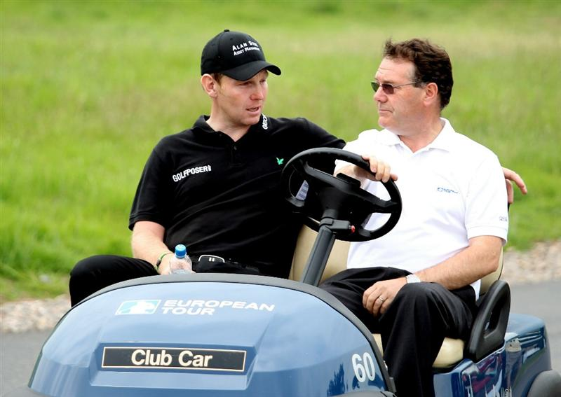 NEWPORT, WALES - JUNE 05:  Stephen Gallacher of Scotland and Gordon Simpsom the European Tour's Press Officer after the third round of the Celtic Manor Wales Open on the 2010 Course at the Celtic Manor Resort on June 5, 2010 in Newport, Wales.  (Photo by Ross Kinnaird/Getty Images)