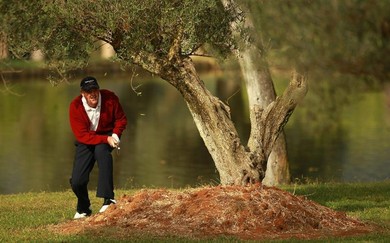 CASTELLON DE LA PLANA, SPAIN - NOVEMBER 05:  Mike Clayton of the USA plays his second shot from behind a tree on the fifth hole during the first round of the OKI Castellon Senior Tour Championships at Club de Campo del Mediteraneo on November 5, 2010 in Castellon de la Plana, Spain.  (Photo by Warren Little/Getty Images)