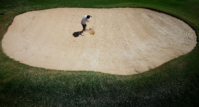 KAPALUA, HI - OCTOBER 17:  Christa Johnson hits out of the green bunker on the 18th hole during the second round of the Kapalua LPGA Classic on October 17, 2008 at the Bay Course in Kapalua, Maui, Hawaii.  (Photo by Donald Miralle/Getty Images)