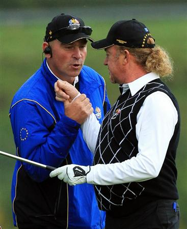 NEWPORT, WALES - OCTOBER 03:  Miguel Angel Jimenez is congratulated by Vice Captain Thomas Bjorn during the  Fourball & Foursome Matches during the 2010 Ryder Cup at the Celtic Manor Resort on October 3, 2010 in Newport, Wales.  (Photo by David Cannon/Getty Images)