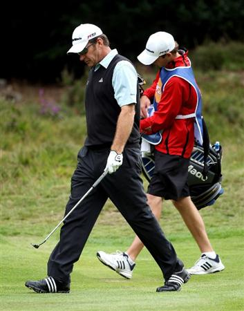 SUNNINGDALE, ENGLAND - JULY 24:  Nick Faldo of England looks dejected as he walks with his caddie and son Matthew Faldo on the second hole during the second round of The Senior Open Championship presented by MasterCard held on the Old Course at Sunningdale Golf Club on July 24, 2009 in Sunningdale, England.  (Photo by Andrew Redington/Getty Images)