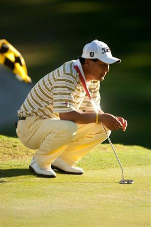 SAN ANTONIO, TX - OCTOBER 29: Chien Soon Lu of Taiwan lines up a putt during the first round of the AT&T Championship at Oak Hills Country Club on October 29, 2010 in San Antonio, Texas. (Photo by Darren Carroll/Getty Images)
