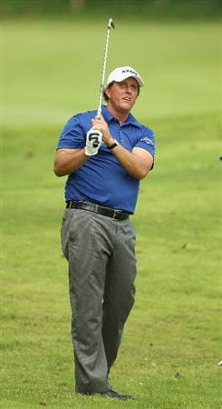 SINGAPORE - NOVEMBER 10:  Phil Mickelson of the United States in action on the 14th hole during the Pro-Am of the Barclays Singapore Open at Sentosa Golf Club on November 10, 2010 in Singapore, Singapore.  (Photo by Ian Walton/Getty Images)