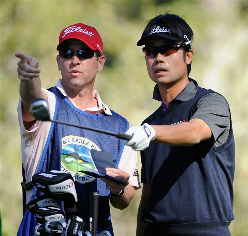 PEBBLE BEACH, CA - FEBRUARY 12:  Kevin Na and caddie gesture during the third round of the AT&T Pebble Beach National Pro-Am at the Spyglass Hil Golf Course on February 11, 2011  in Pebble Beach, California  (Photo by Stuart Franklin/Getty Images)