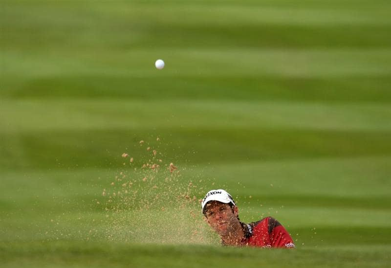 NEWPORT, WALES - JUNE 05:  Bradley Dredge of Wales plays from a bunker on the 1st during the second round of the Celtic Manor Wales Open on the 2010 Course at The Celtic Manor Resort on June 5, 2009 in Newport, Wales.  (Photo by Richard Heathcote/Getty Images)