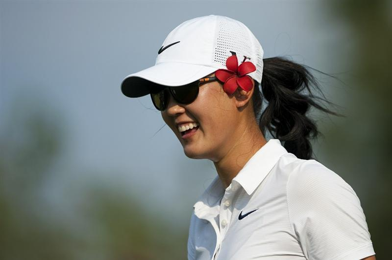 CHON BURI, THAILAND - FEBRUARY 18:  Michelle Wie of USa smiles on the 18th tee during day two of the LPGA Thailand at Siam Country Club on February 18, 2011 in Chon Buri, Thailand.  (Photo by Victor Fraile/Getty Images)