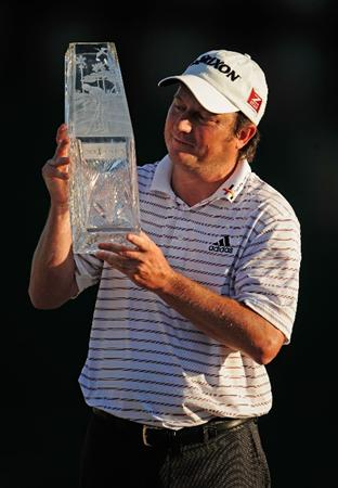PONTE VEDRA BEACH, FL - MAY 09:  Tim Clark of South Africa smiles while holding the trophy after winning THE PLAYERS Championship held at THE PLAYERS Stadium course at TPC Sawgrass on May 9, 2010 in Ponte Vedra Beach, Florida.  (Photo by Richard Heathcote/Getty Images)