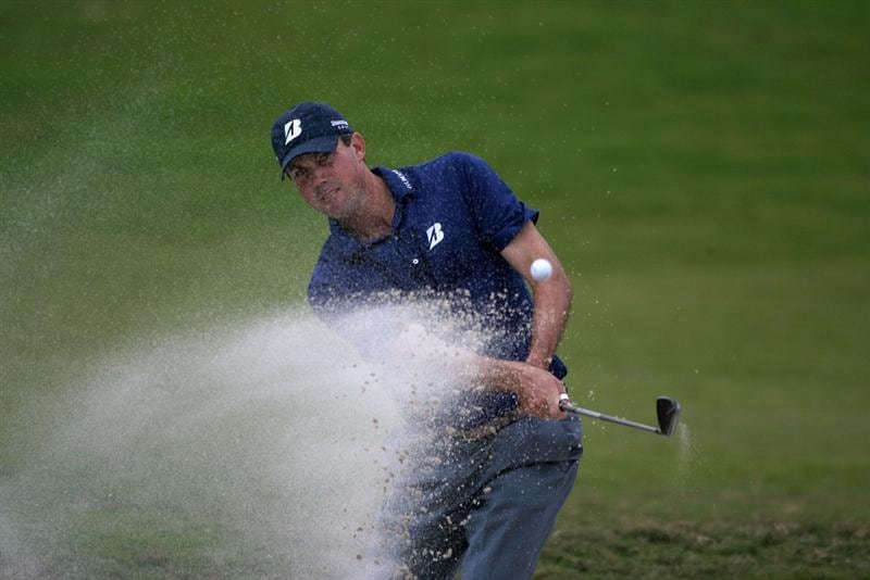 DORAL, FL - MARCH 11:  Matt Kuchar hits out of the bunker on the tenth hole during round one of the 2010 WGC-CA Championship at the TPC Blue Monster at Doral on March 11, 2010 in Doral, Florida.  (Photo by Marc Serota/Getty Images)