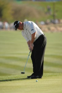 John Rollins hits a putt on the 18th green during the final round of the FBR Open held at the TPC Scottsdale, February 4, 2007 in Scottsdale, Arizona. PGA TOUR - 2007 FBR Open - Final RoundPhoto by Marc Feldman/WireImage.com