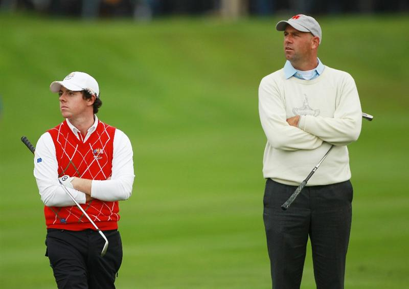 NEWPORT, WALES - OCTOBER 01:  Rory McIlroy of Europe (L) and Stewart Cink of the USA look on during the Morning Fourball Matches during the 2010 Ryder Cup at the Celtic Manor Resort on October 1, 2010 in Newport, Wales. (Photo by Andrew Redington/Getty Images)
