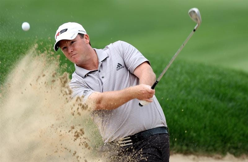 DUBAI, UNITED ARAB EMIRATES - FEBRUARY 07:  Marcus Fraser of Australia on the par five 6th hole during the final round of the Omega Dubai Desert Classic on the Majlis Course at the Emirates Golf Club on February 7, 2010 in Dubai, United Arab Emirates.  (Photo by Ross Kinnaird/Getty Images)