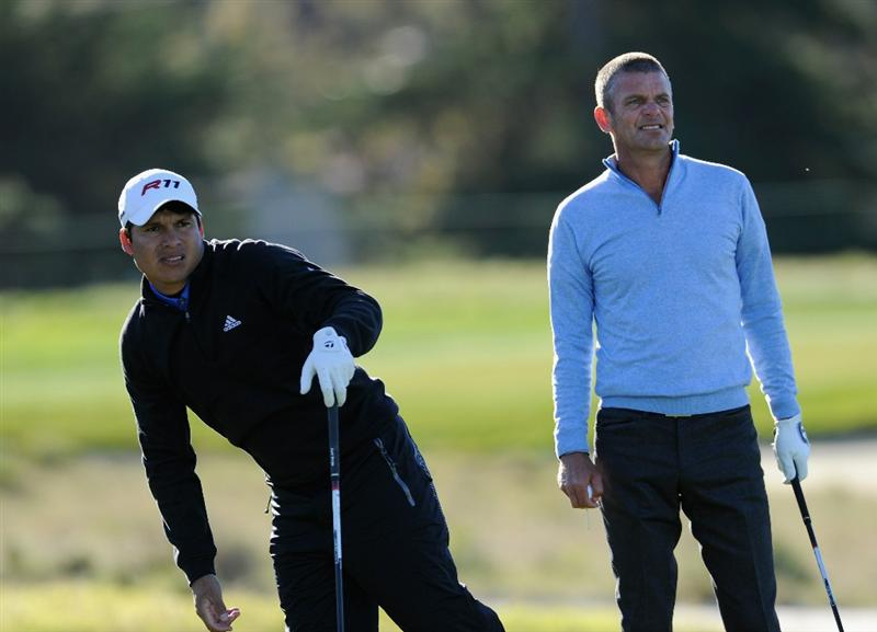 PEBBLE BEACH, CA - FEBRUARY 10:  Andres Romero of Argentina and Jesper Parnevik of Sweden watch a shot during the first round of the AT&T Pebble Beach National Pro-Am at Monterey Peninsula Country Club on February 10, 2011  in Pebble Beach, California.  (Photo by Stuart Franklin/Getty Images)