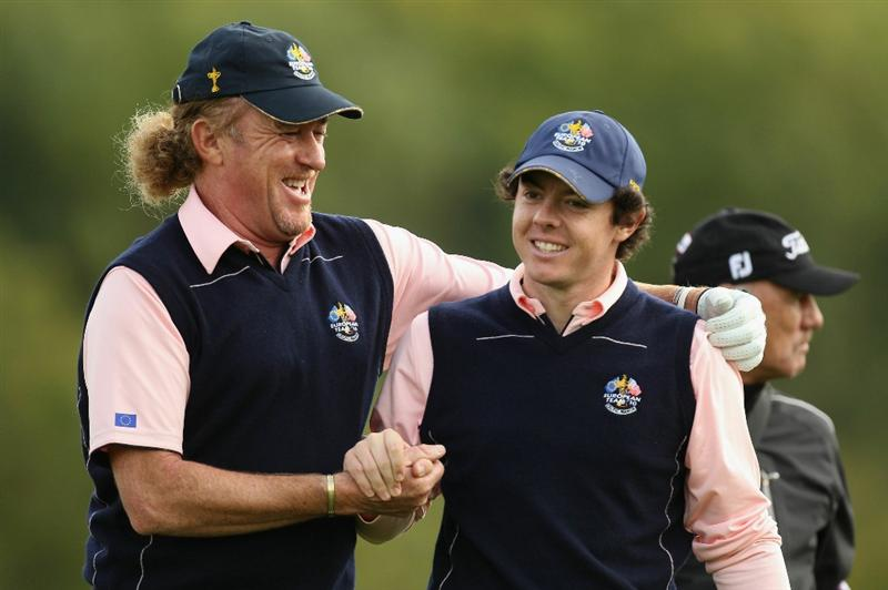NEWPORT, WALES - SEPTEMBER 30:  Europe Team members Rory McIlroy (R) and Miguel Angel Jimenez walk off a tee box during a practice round prior to the 2010 Ryder Cup at the Celtic Manor Resort on September 30, 2010 in Newport, Wales.  (Photo by Ross Kinnaird/Getty Images)