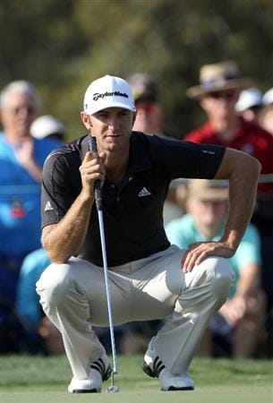 ORLANDO, FL - MARCH 25:  Dustin Johnson plays a shot on the 14th hole during the second round of the Bay Hill Invitational presented by MasterCard at the Bay Hill Club and Lodge on March 25, 2011 in Orlando, Florida.  (Photo by Sam Greenwood/Getty Images)
