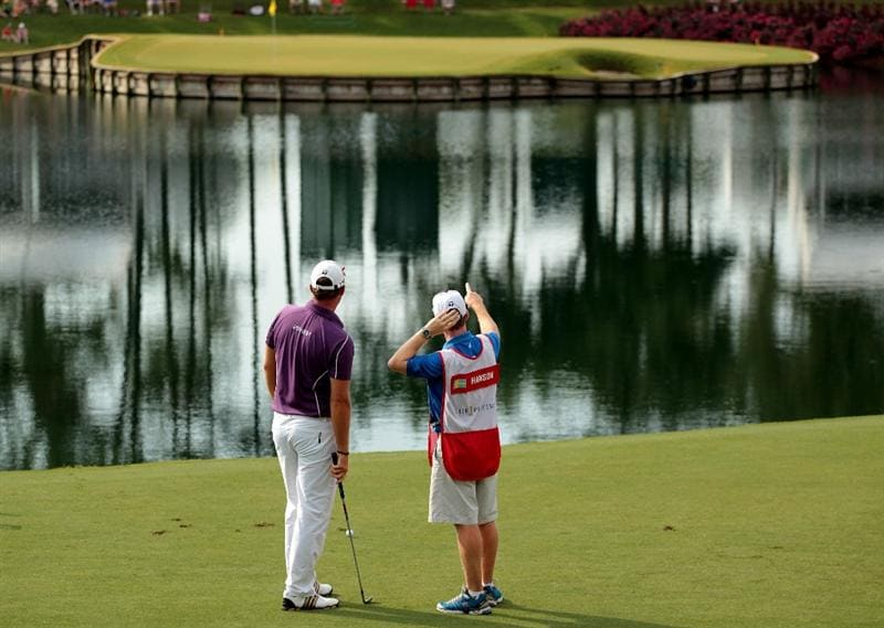 PONTE VEDRA BEACH, FL - MAY 14:  (L-R) Peter Hanson of Sweden talks with his caddie Mark Sherwood before hitting his tee shot on the 17th hole during the third round of THE PLAYERS Championship held at THE PLAYERS Stadium course at TPC Sawgrass on May 14, 2011 in Ponte Vedra Beach, Florida.  (Photo by Scott Halleran/Getty Images)