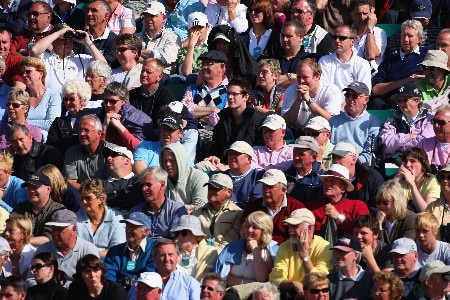 CARNOUSTIE, UNITED KINGDOM - JULY 20:  Golf fans watch the play during the second round of The 136th Open Championship at the Carnoustie Golf Club on July 20, 2007 in Carnoustie, Scotland.  (Photo by Stuart Franklin/Getty Images)