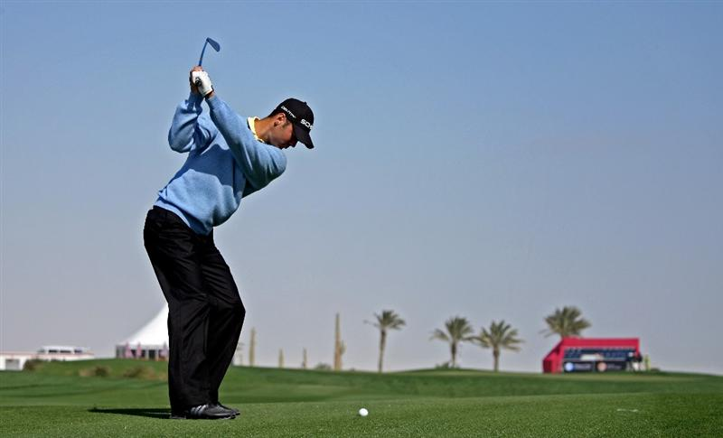 DOHA, QATAR - JANUARY 27:  Martin Kaymer of Germany hits his third shot on the tenth hole during the Pro Am prior to the start of the Commercialbank Qatar Masters at Doha Golf Club on January 27, 2009 in Doha, Qatar.  (Photo by Andrew Redington/Getty Images)