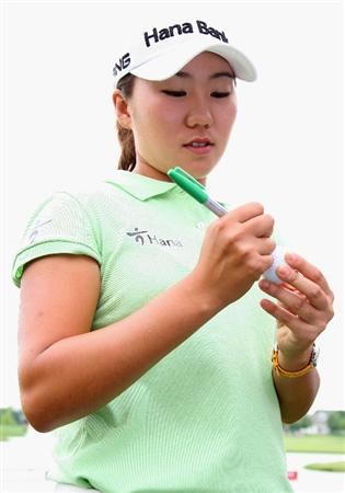SPRINGFIELD, IL - JUNE 07:  In-Kyung Kim of South Korea signs a ball after finishing her fourth round of the LPGA State Farm Classic golf tournament at Panther Creek Country Club on June 7, 2009 in Springfield, Illinois.  (Photo by Christian Petersen/Getty Images)