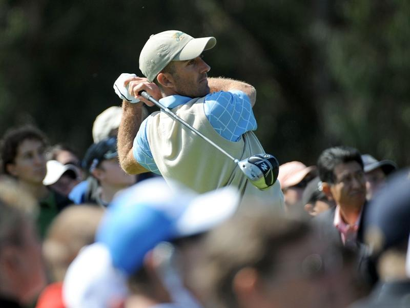 SAN FRANCISCO - OCTOBER 09:  Geoff Ogilvy of the International Team hits a tee shot on the fifth hole during the Day Two Fourball Matches of The Presidents Cup at Harding Park Golf Course on October 9, 2009 in San Francisco, California.  (Photo by Harry How/Getty Images)