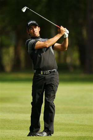 VIRGINIA WATER, ENGLAND - MAY 21:  Pablo Larrazabal of Spain plays an iron shot during the second round of the BMW PGA Championship on the West Course at Wentworth on May 21, 2010 in Virginia Water, England.  (Photo by Ian Walton/Getty Images)