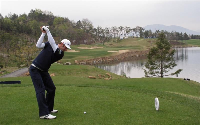 ICHEON, SOUTH KOREA - APRIL 29:  Dustin Johnson of the USA hits his tee-shot on the 13th hole during the second round of the Ballantine's Championship at Blackstone Golf Club on April 29, 2011 in Icheon, South Korea.  (Photo by Andrew Redington/Getty Images)