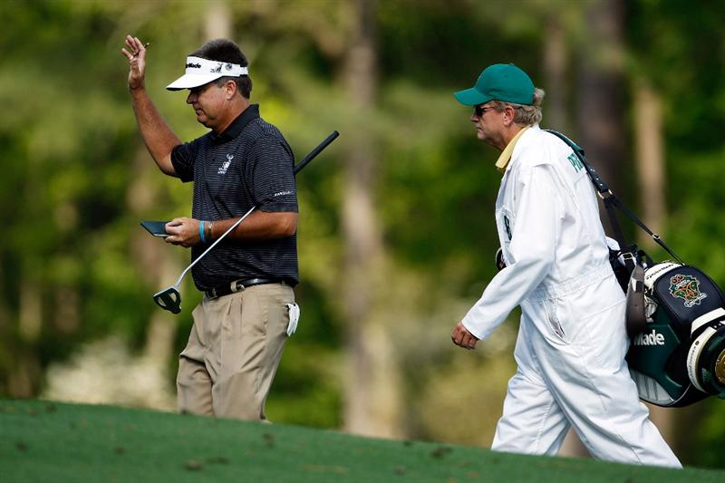 AUGUSTA, GA - APRIL 11:  Kenny Perry walks to the 12th tee with his caddie Fred Sanders during the third round of the 2009 Masters Tournament at Augusta National Golf Club on April 11, 2009 in Augusta, Georgia.  (Photo by Jamie Squire/Getty Images)