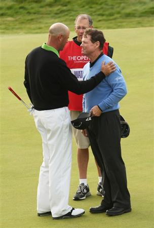 TURNBERRY, SCOTLAND - JULY 19:  Stewart Cink of USA is congratulated by Tom Watson (R) of USA on the 18th green after claiming victory in a play off following the final round of the 138th Open Championship on the Ailsa Course, Turnberry Golf Club on July 19, 2009 in Turnberry, Scotland.  (Photo by Ross Kinnaird/Getty Images)
