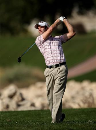 DOHA, QATAR - JANUARY 30:  Bradley Dredge of Wales hits his second shot on the ninth hole during the third round of the Commercialbank Qatar Masters at Doha Golf Club on January 30, 2010 in Doha, Qatar.  (Photo by Andrew Redington/Getty Images)