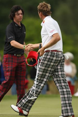 LUSS, SCOTLAND - JULY 09:  Rory McIlroy of Northern Ireland (L) shakes hands with Ian Poulter (R) of England during the First Round of The Barclays Scottish Open at Loch Lomond Golf Club on July 09, 2009 in Luss, Scotland.  (Photo by Andrew Redington/Getty Images)