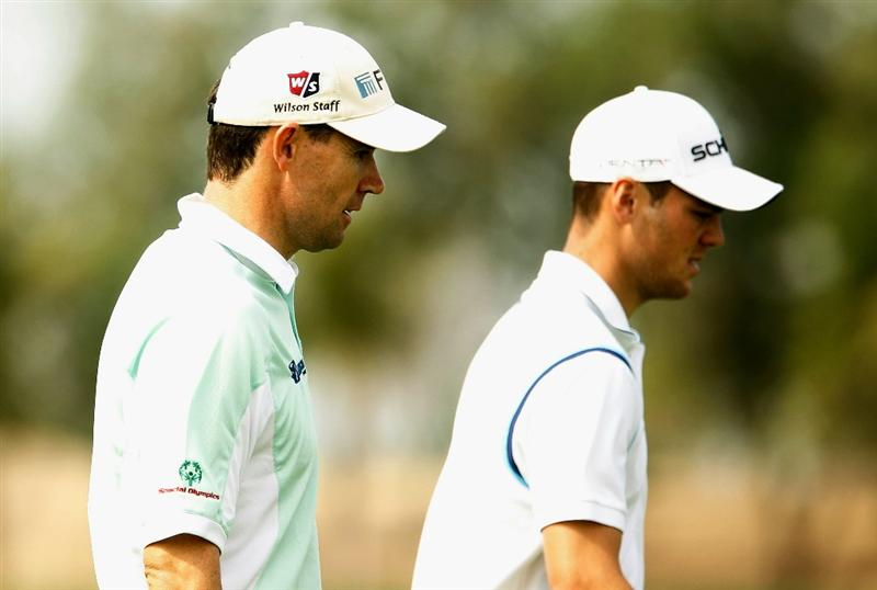 ABU DHABI, UNITED ARAB EMIRATES - JANUARY 20:  Padraig Harrington of Ireland (L) walks with Martin Kaymer of Germany to the 18th green during the first round of the 2011 Abu Dhabi HSBC Golf Championship at the Abu Dhabi Golf Club on January 20, 2011 in Abu Dhabi, United Arab Emirates.  (Photo by Scott Halleran/Getty Images)