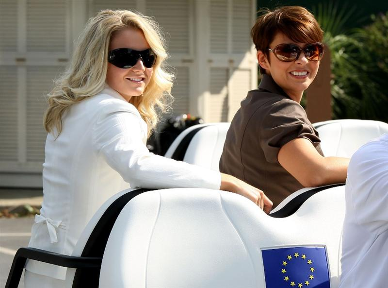 LOUISVILLE, KY - SEPTEMBER 18:  Lauren Smith and Laurae Westwood sit on a golf cart en route to the opening ceremony of the 2008 Ryder Cup at Valhalla Golf Club on September 18, 2008 in Louisville, Kentucky.  (Photo by David Cannon/Getty Images)