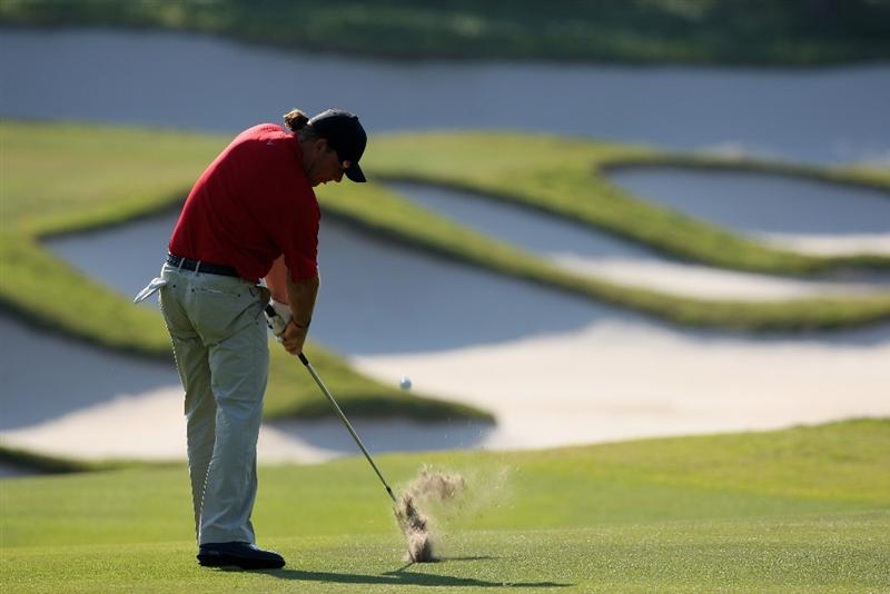 SHENZHEN, CHINA - NOVEMBER 29:  Alex Cejka of Germany plays his approach shot on the 14th hole during the third round of the Omega Mission Hills world cup on November 29, 2008 in Shenzhen, China.  (Photo by Stuart Franklin/Getty Images)