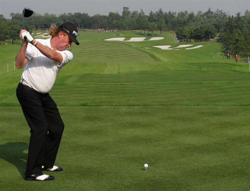 SHANGHAI, CHINA - NOVEMBER 05:  Miguel Angel Jimenez of Spain hits his tee-shot on the first hole during the second round of the WGC-HSBC Champions at Sheshan International Golf Club on November 5, 2010 in Shanghai, China.  (Photo by Andrew Redington/Getty Images)