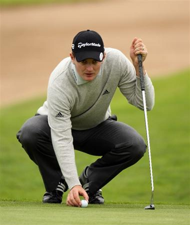 PERTH, UNITED KINGDOM - AUGUST 27:  Justin Rose of England places his ball during the pro-am event prior to The Johnnie Walker Championship at Gleneagles on August 27, 2008 at the Gleneagles Hotel and Resort in Perthshire, Scotland.  (Photo by Ross Kinnaird/Getty Images)