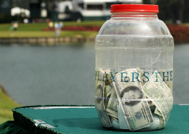 PONTE VEDRA BEACH, FL - MAY 11:  The money jar for the 'Caddie Challenge' is seen on the 17th hole during a practice round prior to the start of THE PLAYERS Championship held at THE PLAYERS Stadium course at TPC Sawgrass on May 11, 2011 in Ponte Vedra Beach, Florida.  (Photo by Scott Halleran/Getty Images)