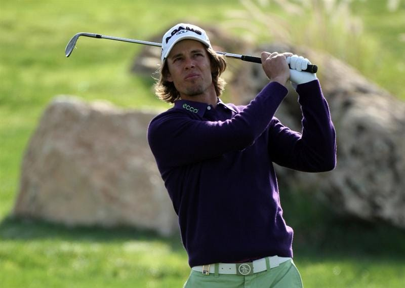 DOHA, QATAR - JANUARY 21:  Aaron Baddeley of Australia plays his second shot on the par four 4th hole  during the pro-am event prior to the Commercialbank Qatar Masters at the Doha Golf Club on January 21, 2009 in Doha, Qatar.  (Photo by Ross Kinnaird/Getty Images)
