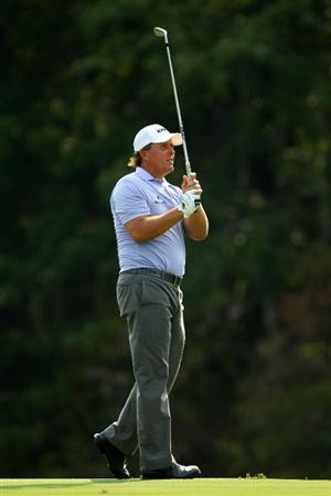 PONTE VEDRA BEACH, FL - MAY 13:  Phil Mickelson hits his approach shot on the 14th hole during the second round of THE PLAYERS Championship held at THE PLAYERS Stadium course at TPC Sawgrass on May 13, 2011 in Ponte Vedra Beach, Florida.  (Photo by Mike Ehrmann/Getty Images)