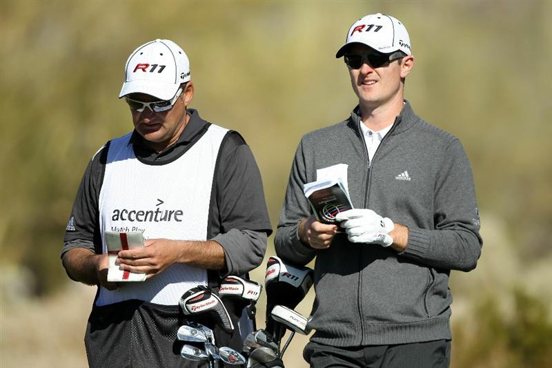 MARANA, AZ - FEBRUARY 24:  Justin Rose of England (R) looks on with his caddie Mark Fulcher from the 16th hole during the second round of the Accenture Match Play Championship at the Ritz-Carlton Golf Club on February 24, 2011 in Marana, Arizona.  (Photo by Andy Lyons/Getty Images)