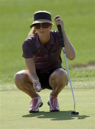 DUBAI, UNITED ARAB EMIRATES - DECEMBER 12: Anna Rawson of Australia lines up a birdie putt at the 8th hole during the second round of the Dubai Ladies Masters on the Majilis Course at the Emirates Golf Club on December 12, 2008 in Dubai,United Arab Emirates  (Photo by David Cannon/Getty Images)