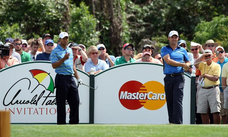 ORLANDO, FL - MARCH 26: Padraig Harrington of Ireland watches his tee shot at the 7th hole as his playing partner Tiger Woods of the USA moves in to play during the first round of the Arnold Palmer Invitational Presented by Mastercard at the Bay Hill Club and Lodge on March 26, 2009 in Orlando, Florida  (Photo by David Cannon/Getty Images)