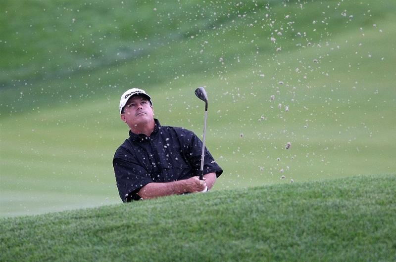 JERSEY CITY, NJ - AUGUST 28:  Paul Goydos hits out of the bunker on the 12th hole during round two of The Barclays on August 28, 2009 at Liberty National in Jersey City, New Jersey.  (Photo by Nick Laham/Getty Images)
