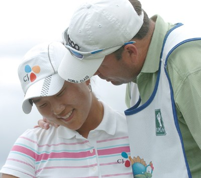 Seon Hwa Lee is consoled by her caddie after losing  a sudden death playoff against Meena Lee in the final round of the inaugural 2006 Fields Open in Hawaii at Ko Olina Golf Club in Kapolei, Hawaii February 25, 2006.Photo by Steve Grayson/WireImage.com