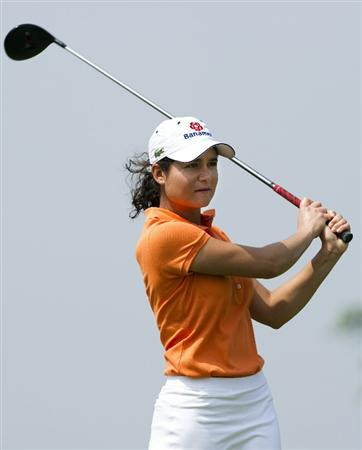 HAIKOU, CHINA - OCTOBER 30:  Lorena Ochoa of Mexico tees off on the 6th hole during day four of the Mission Hills Start Trophy tournament at Mission Hills Resort on October 30, 2010 in Haikou, China. The Mission Hills Star Trophy is Asia's leading leisure liflestyle event and features Hollywood celebrities and international golf stars.  (Photo by Victor Fraile/Getty Images for Mission Hills)