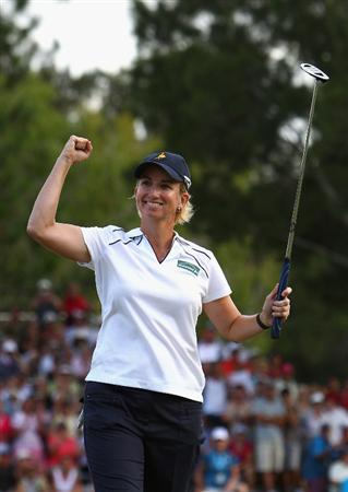 GOLD COAST, AUSTRALIA - MARCH 07:  Karrie Webb of Australia celebrates after sinking her winning putt on the 18th hole during round four of the 2010 ANZ Ladies Masters at Royal Pines Resort on March 7, 2010 in Gold Coast, Australia.  (Photo by Ryan Pierse/Getty Images)