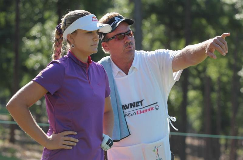 MOBILE, AL - APRIL 28:  Alexis Thompson chats with her father/caddie Scott on the sixth hole during the first round of the Avnet LPGA Classic at the Crossings Course at the Robert Trent Jones Trail at Magnolia Grove on April 28, 2011 in Mobile, Alabama.  (Photo by Scott Halleran/Getty Images)